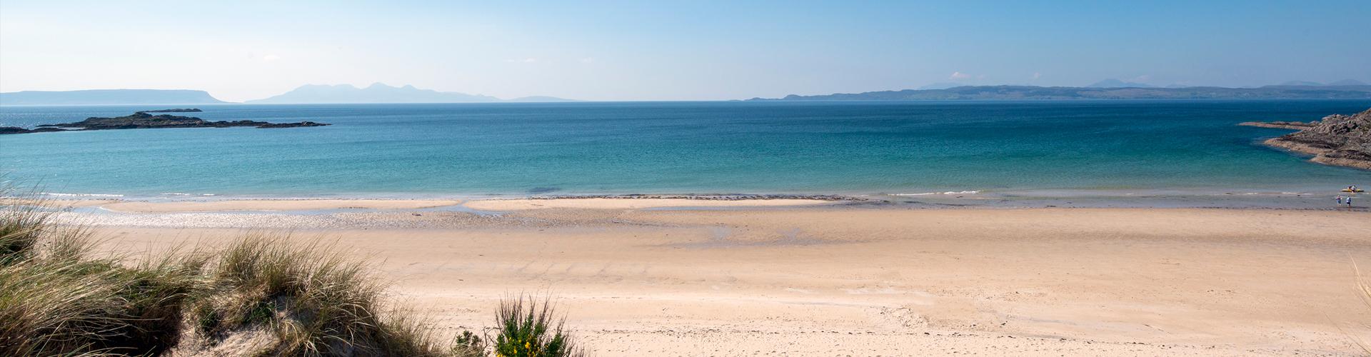 Camusdarach beach looking across the sea to Skye, Eigg and Rum