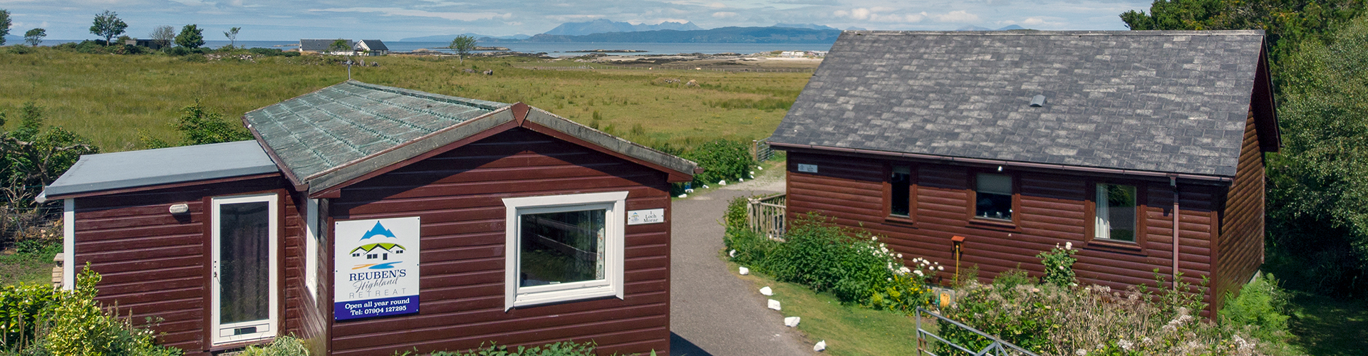 Entrance to Reuben's Highland Retreat with the Isle of Skye in the background